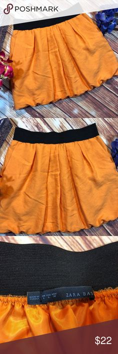 "Zara Basic Orange bubble short Skirt Stretch waist Please see photos for exact condition SHIPS FAST Feel free to ask questions Measurements are approximate Please compare measurements to your own favorite clothing to help avoid having a return  waist 30"" stretch band length 17""  Thank you! Zara Skirts Mini"