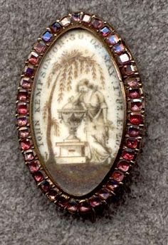Hairwork on ivory....garnets surround this memorial brooch 1783.