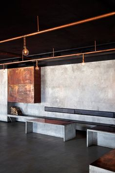 Betonas ir metalas puikiai dera. Hearth and Home: Why Architects Are Warming Once Again to the Age-old Hearth