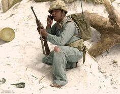 A US Navajo Marine communicating over his radio in the field of battle, Pacific theatre WWII.