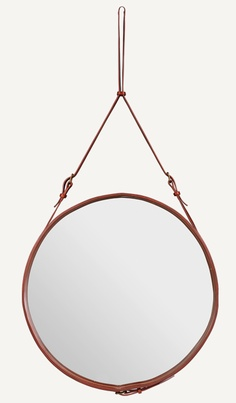 Belted mirror from Gubi. Midcentury design by Jaques Adnet for Hermes