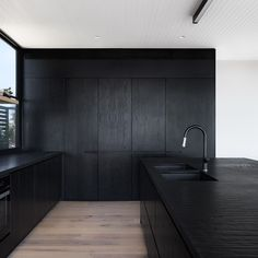 "Meraki Creative Architecture on Instagram: ""INTERIORS: From white to black. Interior shot of kitchen at our Blairgworie Residence. Black timber veneer joinery and textured stone…"""