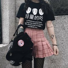 B&w tee tucked into plaid skirt. Black pantyhose under black fishnets. Black backpack. Black bracelet