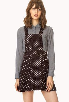 An overall dress featuring a polka dot print. Square neckline. Adjustable straps. Invisible back...