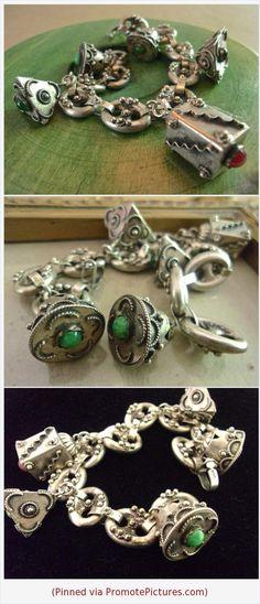 Etruscan 800 Silver Charm Bracelet, Italian Peruzzi Art Deco, Antique-Vintage #bracelet #etruscan #revival #800silver #peruzzi #style #artdeco #charm #fob #gemstones #red #green #vintage https://www.etsy.com/RenaissanceFair/listing/598070519/etruscan-800-silver-charm-bracelet?ref=listings_manager_grid  (Pinned using https://PromotePictures.com)