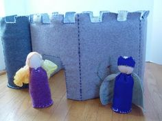 Felt and cardboard castle.  To make a more lasting version, substitute cross-stitch grid for the cardboard.