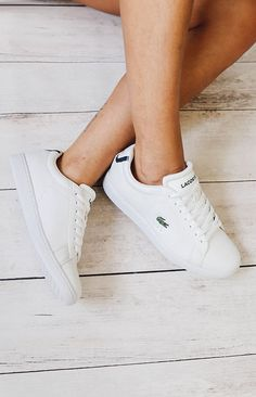 A pair of cool sneakers from Lacoste your wardrobe needs. Mix it with a dress or denim shorts for a sporty chic look.
