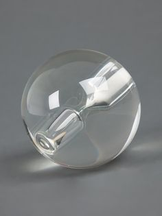 "MAISON MARTIN MARGIELA, SPHERE HOURGLASS TIMER: ""during a 5-minute session, this ball hourglass designed by mmm gradually tilts from one side to the next as more sand falls to the opposite end."" so. awesome."