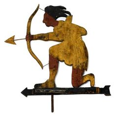Painted and carved wooden weathervane of an Indian shooting an arrow. Silhouetted kneeling form.