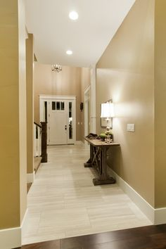 Light tile with a seamless transition to dark wood floor. Perfect!                                                                                                                                                      More