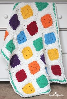 Super soft squares and bright vibrant colors! You won't be able to resist cuddling up with this Bright and Bulky Bernat Blanket. Made with the every so fluffy and chunky Bernat Blanket Yarn in their B Crochet For Beginners Blanket, Baby Afghan Crochet, Afghan Crochet Patterns, Crochet Blankets, Baby Afghans, Crochet Granny, Crochet Pouch, Crochet Pillow, Chrochet
