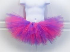 Tutus are so much fun!! This pretty pink and purple is perfect for: *Halloween - Cheshire Cat costume *photo shoots *birthdays and/or cake smashes *dance performances *school events *dress up - perfect princess tutu! *parties *just because! This tutu has a stretchy waistband and is 8 in length (Id suggest 5-6 for newborn to 9 months, 8 for 1-4yo, 10 for 5-8yo and 12 for 9+ - longer lengths can be made, just ask for pricing). I can make this in an adult size, message me for informa...