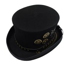 """Leather band with brass color rivets and chain. Watch pieces and leather cord accent the crown. Crown 5"""" high. 2"""" wide rolled brim. Lined with red silk. Leather sweatband with drawstring. 100% Austral"""