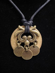 urban artifact necklace - bronze washer, three brass discs, brass jewelry component. $20.00, via Etsy.