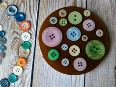 Brown background with real assorted coloured buttons resin coaster