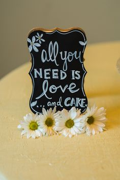 All you Need Is Love... And Cake. Cake Sign. Wedding decor. Yellow. Daisy. Cake Sign by: Poco Post Photo by: Modified PhotoGraphics  PRESENTED BY WHITE DAISY EVENTS