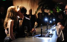 Oscars 2015: Governors Ball  Lead actor winner Eddie Redmayne kisses his new bride Hannah Bagshawe . AWWWWW
