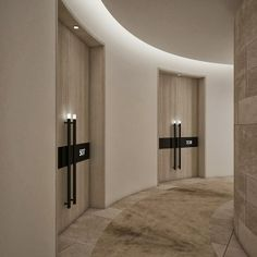 sandblasted bleached oak doors with bronze handles and integrated lighting - Absalom Hotel by Nitzan Design