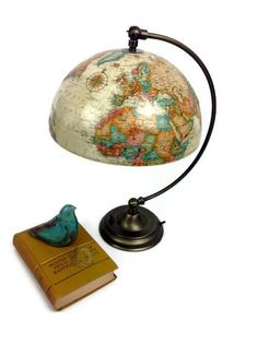 Vintage ivory globe upcycled into lamp with adjustable shade. So cool.