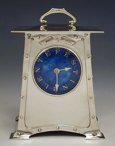 Liberty & Co clock, designer Archibald Knox, 1903.  Silver with enamel dial.  (Price on application).  #antiques #collectables
