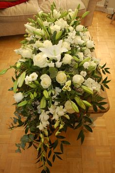 Casket spray Lilies, Roses and Orchids. #bishopandpolden