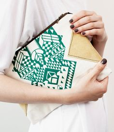 green + gold patterned clutch.