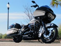 Beach House Harley-Davidson Custom Built 2016 Road Glide Special FLTRXS  Custom paint #217 out of 400 This baby is blacked out!!  •Blacked out heavy breather •Blacked out front end •Blacked out wheels •Stage one with Rhinehart® exhaust •BOOM® audio saddle bag speakers •Slammer saddle bags •Leather solo seat •H-D ape hangers