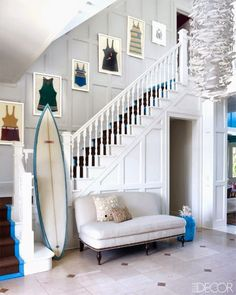 Chic surf retro style coastal entryway in a Hamptons beach house.