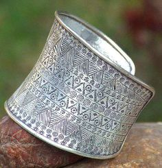 Skyler White: Silver cuff bracelet (two on right arm)
