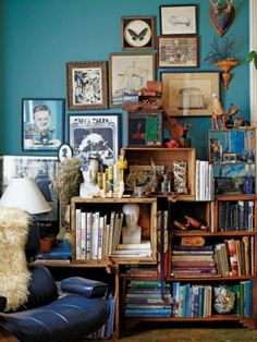 I love books, prints, and knick-knacks. I also love turquoise and teal. My room follows this style. I just need to get my books back from my ex.
