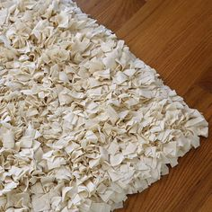 DIY nursery rug ~ buy a rug hooking canvas from the craft store and about 3 yards of stretchy jersey cotton fabric. In total it should cost about $25 - cut 1in by 3in strips of fabric, skip rows, and put the pieces in through one square and out another.