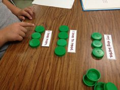 Kids push up one lid for each word in a sentence to help them understand what a word is (concepts of print.)