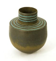 """John Ward, UK. Stoneware. Height 7 1/2""""  x Width 6 1/2""""  One of Britains best known and most widely respected living potters, John Ward has produced a body of work comprised of mainly coil built stoneware vessel forms, generally favoring matte glazes and hand applied oxides. Each piece is hand built of flattened coils; some are then cut and rejoined, incised with a pattern or burnished with pebbles. They are then twice fired in an electric kiln."""