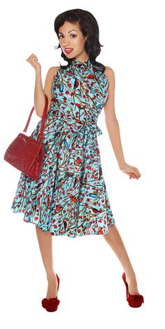 Heather Dress by Folter. Sky Blue With Birds Perched On Branches With Heart Shaped Leaves 100% Cotton 50's Style Swing Dress. High Wrap Collar, Adjustable Sash,  Built In Crinoline and Side Zipper.