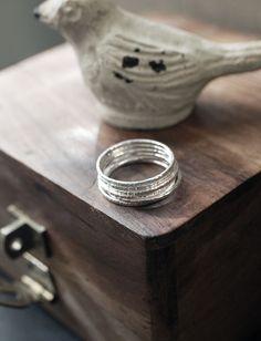 Boca Boheme Woodgrain Texture, Whisper Thin, 1mm Stacking Rings Solid .999 Fine Silver (Set of 6) $80.00  *custom orders welcome  https://www.etsy.com/listing/224492503/delicate-1mm-woodgrain-stacking-rings?ref=shop_home_active_5