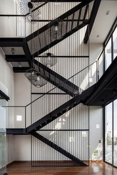 Interior Design Magazine: The focal point of this Bangkok residence by Stu/D/O Architects is an expansive vertical space—four . Stairway Lighting, Escalier Design, Stair Handrail, Railings, Steel Stairs, Exterior Stairs, Outdoor Stairs, Modern Stairs, Interior Design Magazine