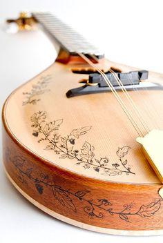 Dove sound hole Mandolin. $1,200.00, via Etsy.