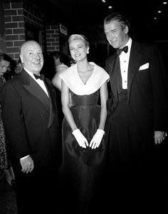 "Alfred Hitchcock,Grace Kellyand Jimmy Stewart at the premiere of ""Rear Window"""