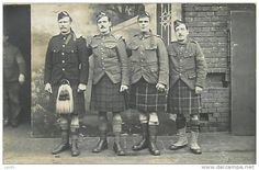 WWI Scottish soldiers--note how two of them have turned their tunics inwards at hem to create the appearance of the Scottish service jackets.