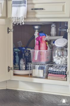Clean up that awkward, ugly space in your kitchen for more efficient use - check out the post for several ideas for organization for under the kitchen sink!