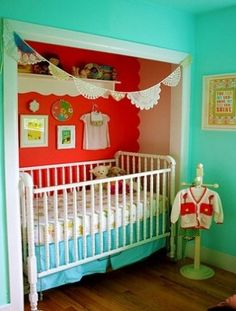 Crib in closet idea- not the bright colors... just the space idea :-) could place skinny shelves at each end and even leave in the highest shelf above