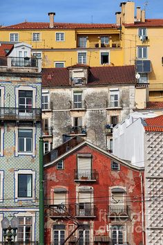 Old houses colorful facades in the Alfama district of Lisbon in Portugal. #lisbon #lisboa #house #portugal #portuguese #home #facade #city #alfama