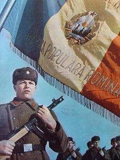 Romanian soldier with the Communist Romanian Flag Communism, Socialism, Romanian Flag, Romanian People, Creepy History, Warsaw Pact, Russian Revolution, East Germany, Soviet Union