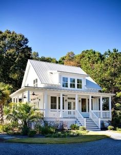 Little white house with porch and tin roof. My dream home in the country some day! House With Porch, My House, Porch Around The House, House With Land, Little White House, Cute Little Houses, Modern Farmhouse Exterior, Rustic Farmhouse, Fresh Farmhouse