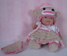 """Crocheted Pink Sock Monkey Hat And Dress Set For 5"""" Itty Bitty Berenguer Doll. $29.99, via Etsy."""
