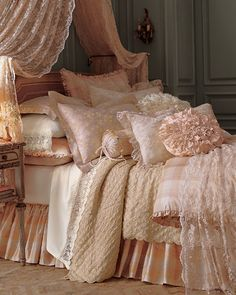 lovely shabby chic bed, i especially love the draped canopy ... the very sheer fabric lower on the bed is nice too