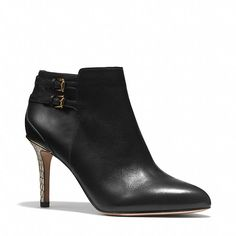 Coach DAPHNEY BOOTIE Crafted in beautifully stitched, soft-grained leather, this sophisticated, modern bootie is accented with custom buckles at the ankle that play up its graceful contours and an edgy snake-wrapped heel.