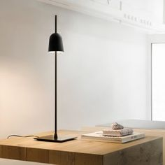 A lamp that dims as it goes up and down the stem! Genius! Ascent lamp by Daniel Rybakken  for Luceplan