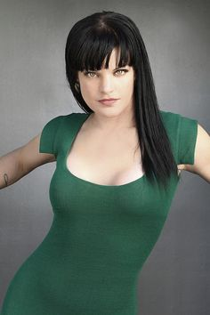Pauley Perrette is out of her Abby character in this form fitting dark green dress.  She plays forensic scientist Abby Sciuto of NCIS.