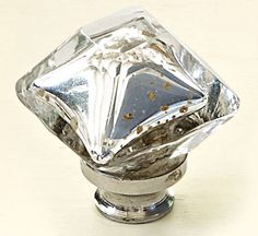 Timeworn mercury glass gets an update in a modern pyramidal shape. A nice for that Hollywood glamour style. Antique Silver Mercury Square Design, $8.50; Dwyer Home Collection